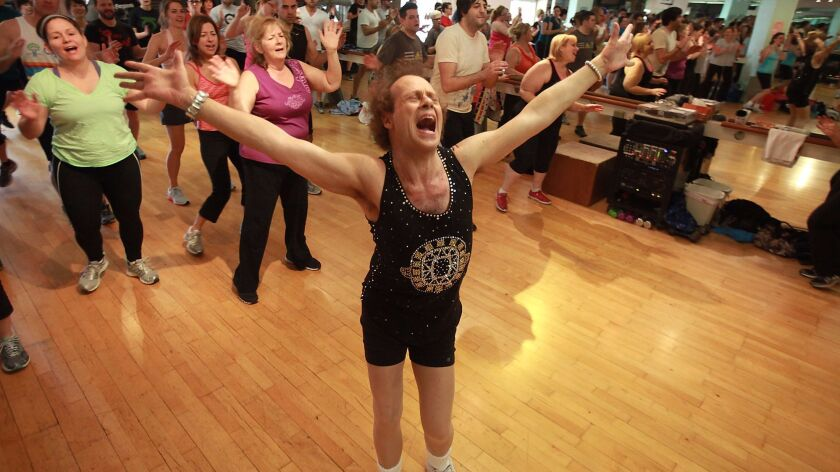 Fitness guru Richard Simmons works with the crowd at his Beverly Hills studio in 2013.