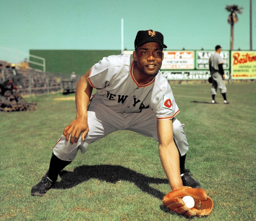 Monte Irvin, shown in 1952 with the New York Giants, was just back from World War II service in 1945 when he declined Branch Rickey's offer to sign with the Brooklyn Dodgers.
