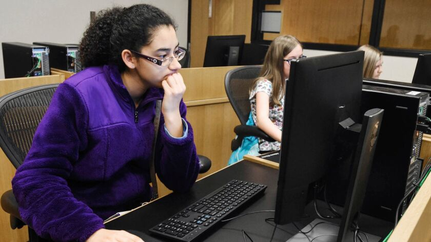 Serena Perez-Takaya works on making a phone app simulation at the Allen County Public Library in Fort Wayne, Ind. on Feb. 15.