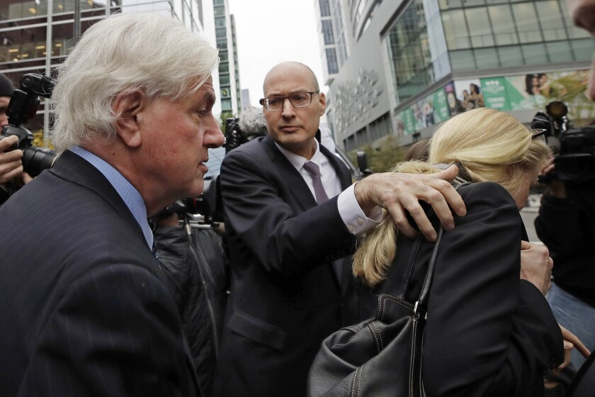 Gregory Abbott and Marcia Abbott outside Boston federal court in May