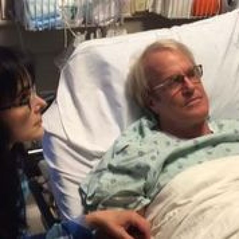 Composer, radio and TV personality John Tesh undergoes a chemotherapy treatment for cancer with wife Connie Sellecca.