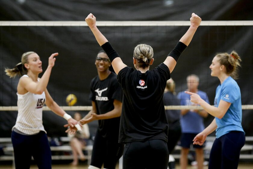 In this photo Tuesday, May 24, 2016, photo, Kayla Banwarth celebrates a point with teammates during volleyball practice in Anaheim, Calif. The Olympic-bound U.S. women's volleyball team has struck a close-knit bond that allowed for successful, honest peer evaluations last year. (AP Photo/Chris Carl