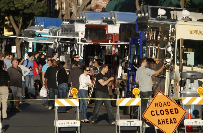 Gaslamp Quarter restaurants aren't happy about weekly food truck gatherings on J Street in downtown San Diego.