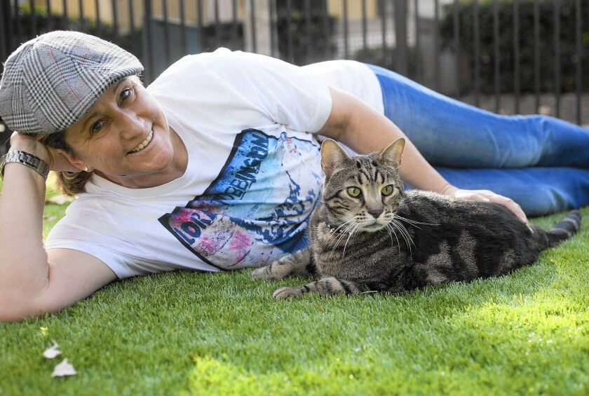 """CeCe Card of Anaheim poses for a portrait with actor Aragon The Cat, an 8-year-old male cat famous for his role as""""Lord Tubbington in the hit TV series Glee."""
