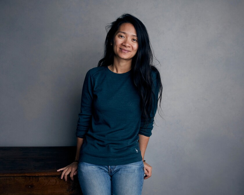 """FILE - In this Jan. 22, 2018, file photo, Chloe Zhao poses for a portrait during the Sundance Film Festival in Park City, Utah. Chloe Zhao's success as the first Asian woman and the second woman ever to win a Golden Globe for best director for her film """"Nomadland"""" has not been met with universal applause in the country where she was born.(Photo by Taylor Jewell/Invision/AP, File)"""