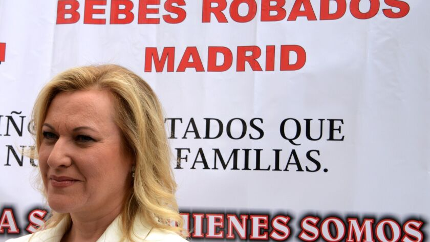 """Ines Madrigal, who was taken from her mother as an infant and given to another family, attends a demonstration against Spain's """"stolen babies"""" scandal of the Franco era in Madrid on June 18, 2013."""