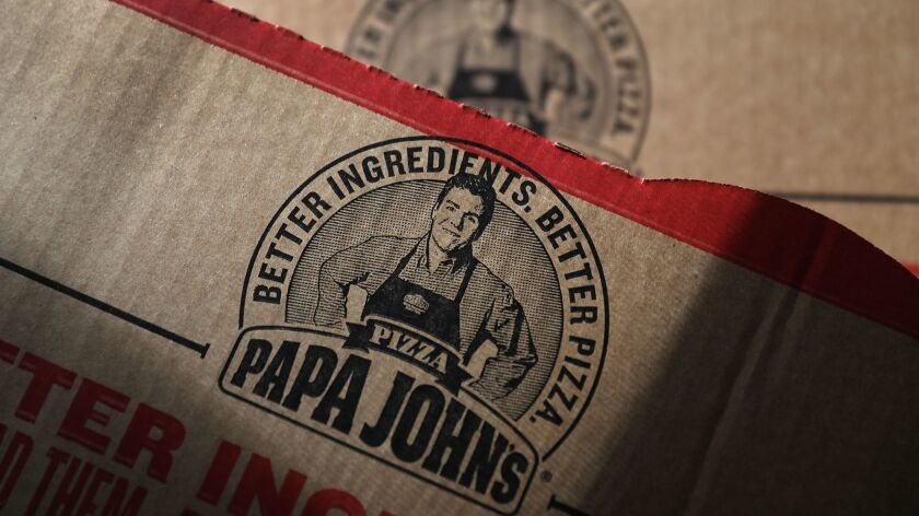 A Papa John's pizza box features an image of founder John Schnatter. The company is trying to distance itself from its former chief executive.