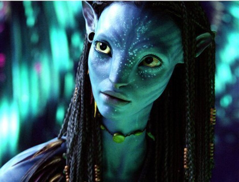 "FILE - This undated file photo released by 20th Century Fox, the character Neytiri, voiced by Zoe Saldana, is shown in a scene from ""Avatar."" James Cameron's science-fiction epic took in $68.3 million domestically to remain the No. 1 movie for the third-straight weekend, raising its domestic total to $352.1 million in just 17 days. With $670 million more overseas, ""Avatar"" climbed to a worldwide total of $1.02 billion. (AP Photo/20th Century Fox, File)"