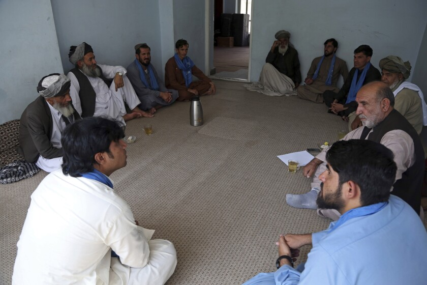 On Tuesday, the Taliban ambushed a peace convoy in Farah province in western Afghanistan and abducted 26 activists, members of a peace movement. Above, members of the peace movement chat after an interview in Kabul, Afghanistan, in August.