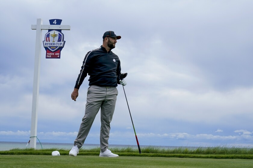Team Europe's Jon Rahm watches his drive on the fourth hole during a practice day at the Ryder Cup at the Whistling Straits Golf Course Thursday, Sept. 23, 2021, in Sheboygan, Wis. (AP Photo/Charlie Neibergall)