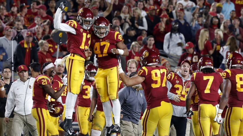 The USC sideline celebrates after the Trojans defense forced a turnover on downs against Colorado on Oct. 13.