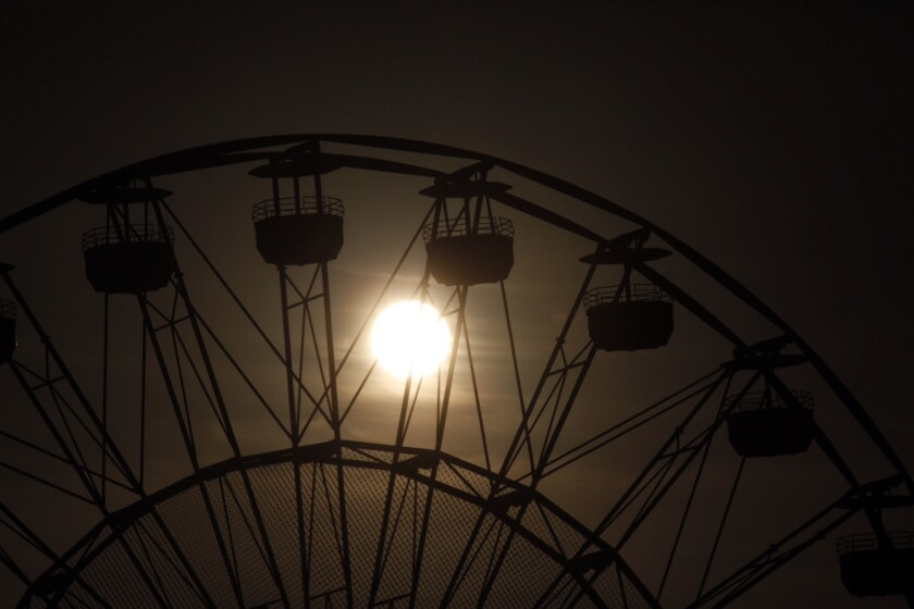 Sunrise over the Ferris wheel at the Irvine Spectrum. Southland temperatures are expected to climb through the weekend with highs topping 100 degrees in parts of the San Fernando Valley.
