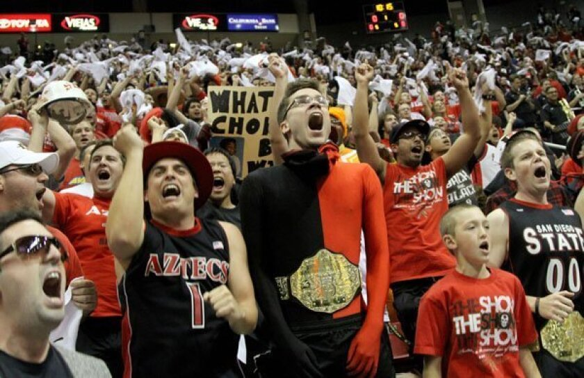 Aztec Fans go wild as SDSU Mens basketball team beat UNLV at Viejas Arena on the campus of SDSU on Wednesday January 12, 2011.