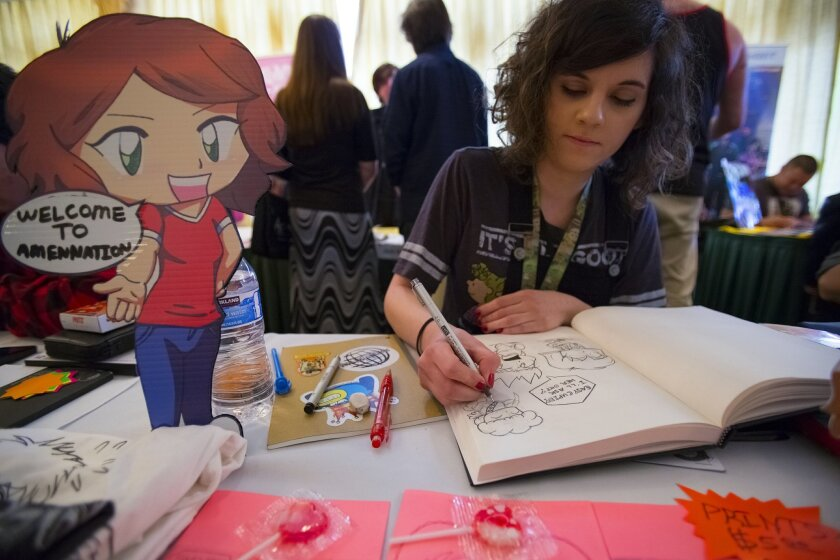 .Becky Yard from Chula Vista works on one of her comic character sketches in the Artist Alley section of San Diego Comic Fest held in Mission Valley...