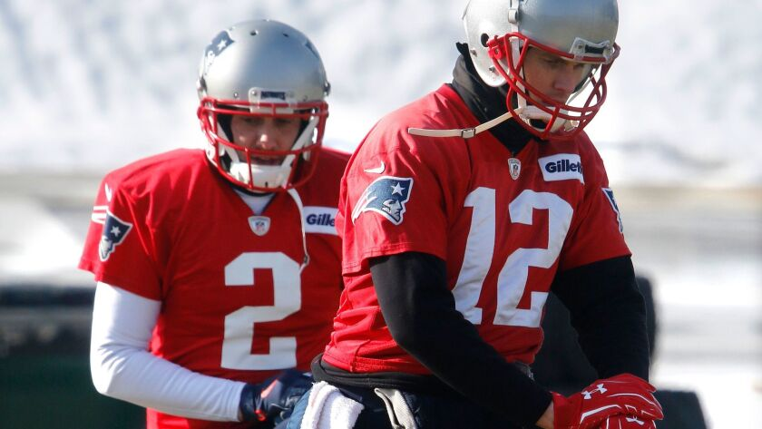 New England Patriots quarterbacks Tom Brady (12) and Brian Hoyer (2) warm up during a practice on Friday. The Patriots host the Jacksonville Jaguars in the AFC championship game.