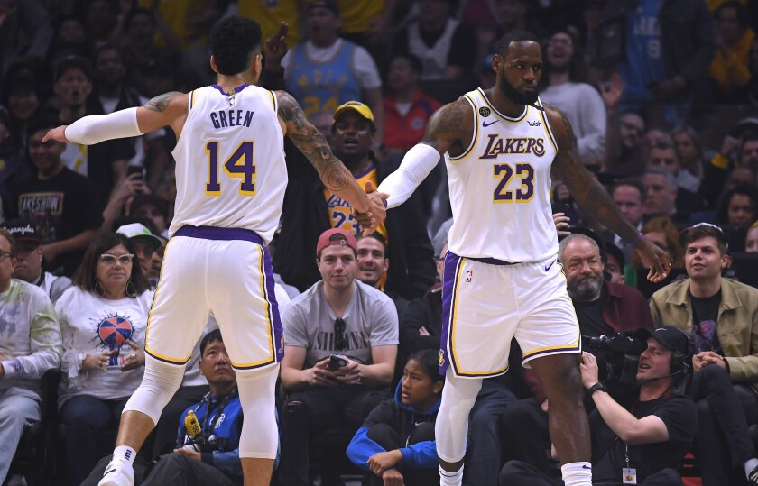 Lakers All-Star forward LeBron James (23) celebrates with teammate Danny Green after scoring against the Clippers during a victory on March 8, 2020.