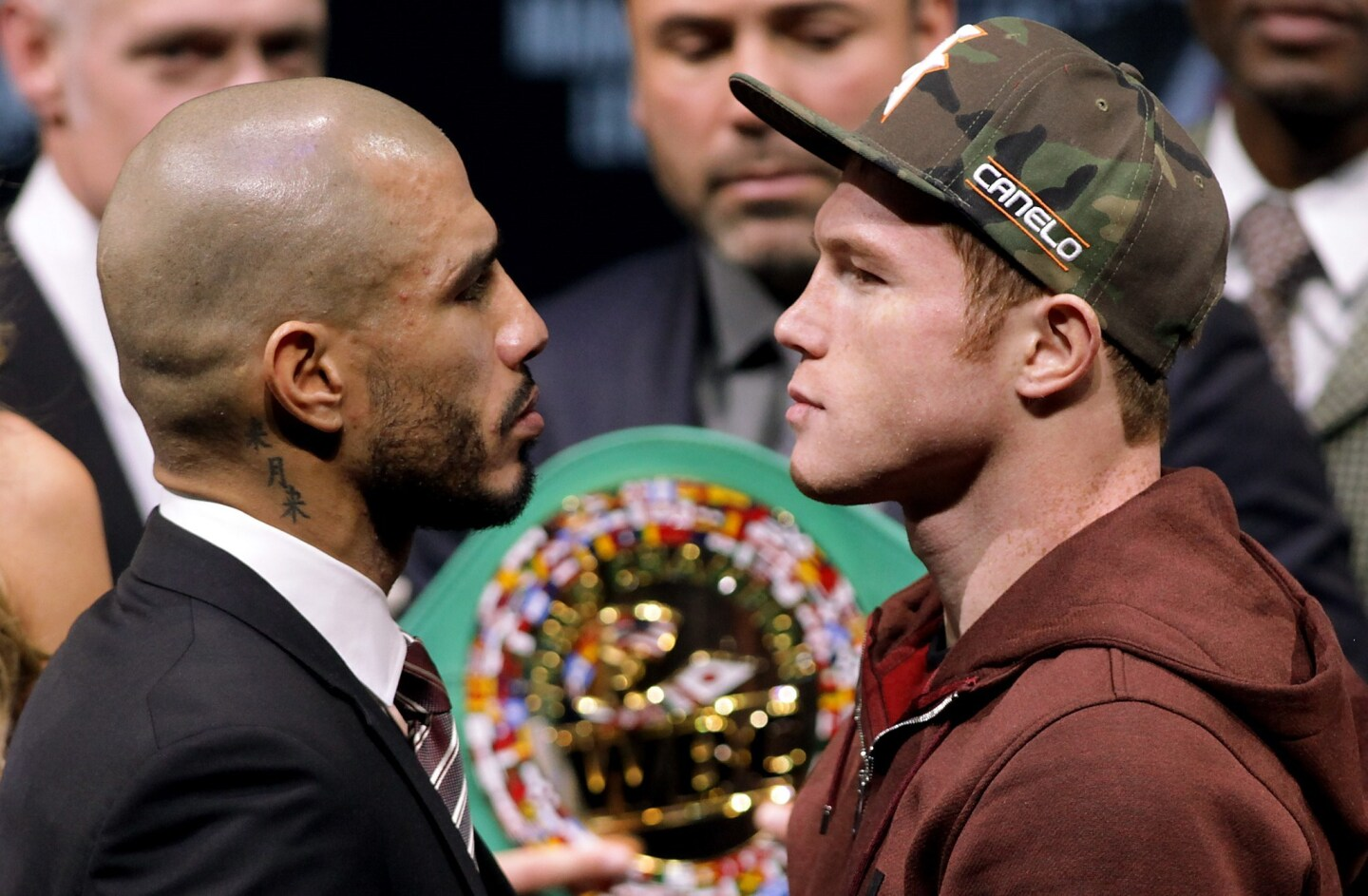 Former WBC Middleweight World Champion Miguel Cotto (L), from Puerto Rico and two time world champion, Saul 'Canelo' Alvarez from Guadalajara, Mexico face-off during a press conference in Las Vegas, Nevada on November 18, 2015. Cotto was stripped of his World Boxing Council middleweight world title on Tuesday, days before his anticipated bout against Mexican Saul Alvarez in Las Vegas on Saturday. Amid reports that Cotto declined to pay the USD 300,000 sanctioning fee for a title fight, the WBC said in a statement only that the Puerto Rican and his camp failed to comply with WBC regulations. AFP PHOTO/ John GurzinskiJOHN GURZINSKI/AFP/Getty Images ** OUTS - ELSENT, FPG, CM - OUTS * NM, PH, VA if sourced by CT, LA or MoD **