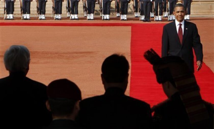 U.S. President Barack Obama, right, inspects the guard of honor during a ceremonial reception at Rashtrapati Bhavan, the Presidential Palace in New Delhi, India, Monday, Nov. 8, 2010. Obama is on a three-day visit to the world's largest democracy. (AP Photo/Manish Swarup)