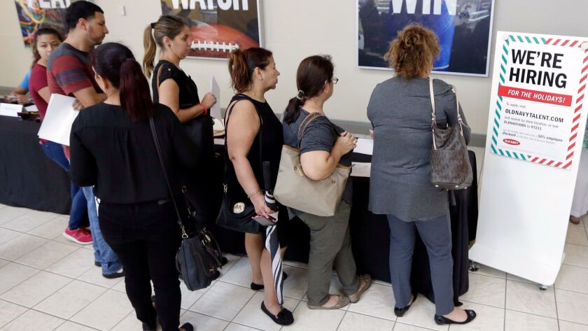 People wait in line at a job fair in Florida.