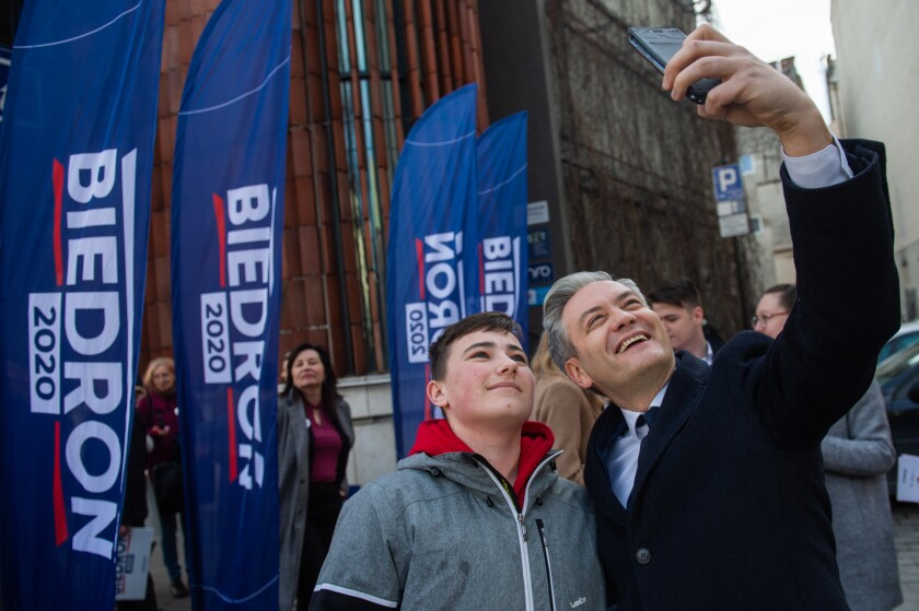 Robert Biedron takes a selfie with a supporter in the main square of  Krakow, Poland.