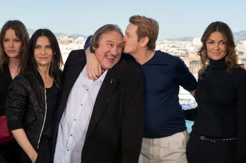 "Stephane Caillard, Gerard Depardieu, Benoit Magimel and Nadia Fares pose during a photocall for the premiere of the French TV show ""Marseille."""
