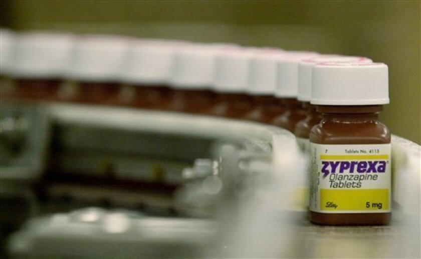 FILE - In this April 10, 2003 file photo, bottles filled with the drug Zyprexa sits on the packaging line at the Eli Lilly & Co. Dry Products Packaging Facility in Indianapolis. Eli Lilly said Thursday, Dec. 10, 2009, it still expects its earnings per share to grow in the double-digit range through 2011 and added it plans to launch two new medicines per year starting in 2013.(AP Photo/Darron Cummings, file)