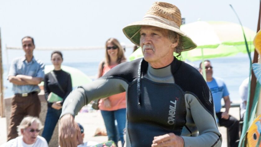 Laguna Bluebelt Coalition co-founder Mike Beanan entertains the crowd during a past Kelp Fest in Lag