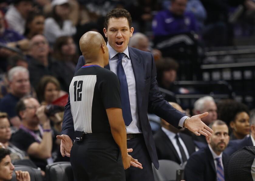 Kings coach Luke Walton talks with referee C.J. Washington against the Lakers on Feb. 1, 2020.
