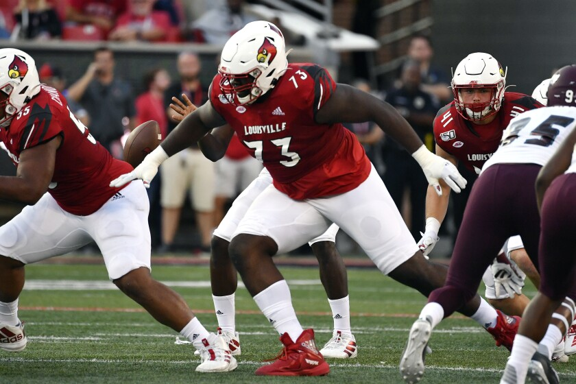 Louisville offensive lineman Mekhi Becton blocks during a game against Eastern Kentucky.