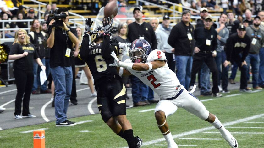 Idaho's Callen Hightower makes a touchdown reception in front of South Alabama's Jalen Thompson on Nov. 26.