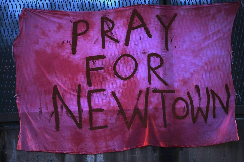 Connecticut state police have released a report concluding their investigation of the Dec. 14, 2012, Newtown school shooting that left 20 children and six women dead inside Sandy Hook Elementary School. After the shooting the town saw numerous flags and signs go up memorializing the tragedy.