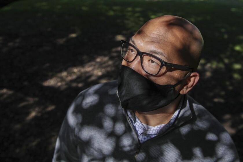 Chong Taing wearing a mask in Arcadia County Park