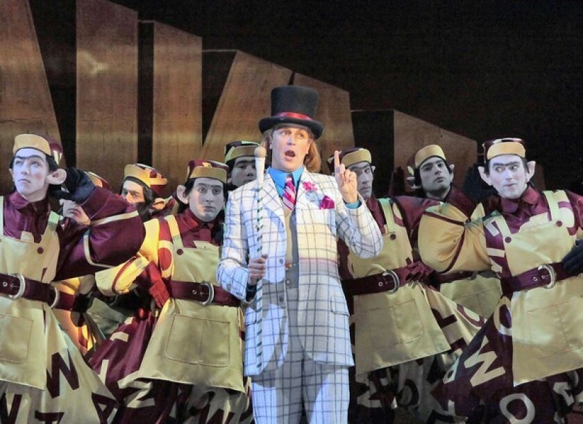 "Daniel Okulitch as Willy Wonka with the Chorus of Oompa Loompas in Opera Theatre of St. Louis' 2010 production of ""The Golden Ticket."""