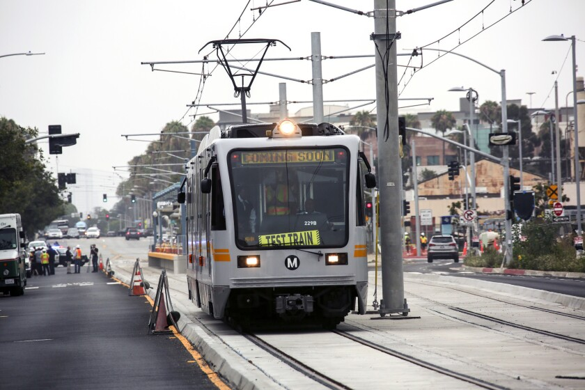 An Expo Line test train moves into Santa Monica during a July test run. A light-rail train derailed after striking a truck that crossed the tracks.