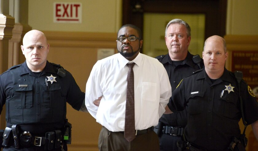 Allen Wade, center, is escorted through the hallway at the Allegheny County Courthouse in Pittsburgh, Thursday, May 26, 2016. Wade, convicted of killing sisters Susan Wolfe, 44, and Sarah Wolfe, 38, daughters of an Iowa state lawmaker, was sentenced Thursday to life in prison without parole after a