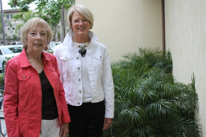 La Jolla Garden Club members Nancy Koch and Roberta Saunders with some of the newly planted shrubbery at La Jolla Library. Ashley Mackin