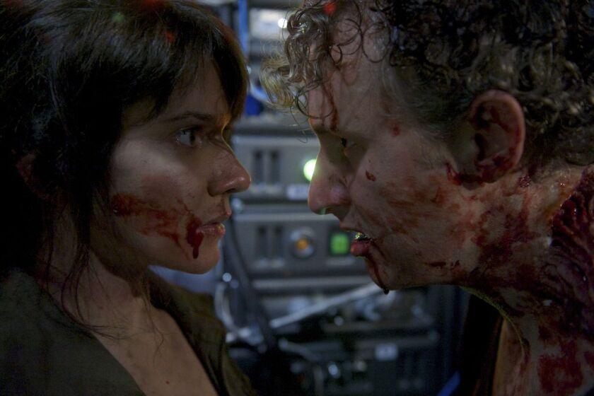 """(L-R) Amy Matysio and Michael Therriault in the sci-fi thriller """"Stranded."""""""