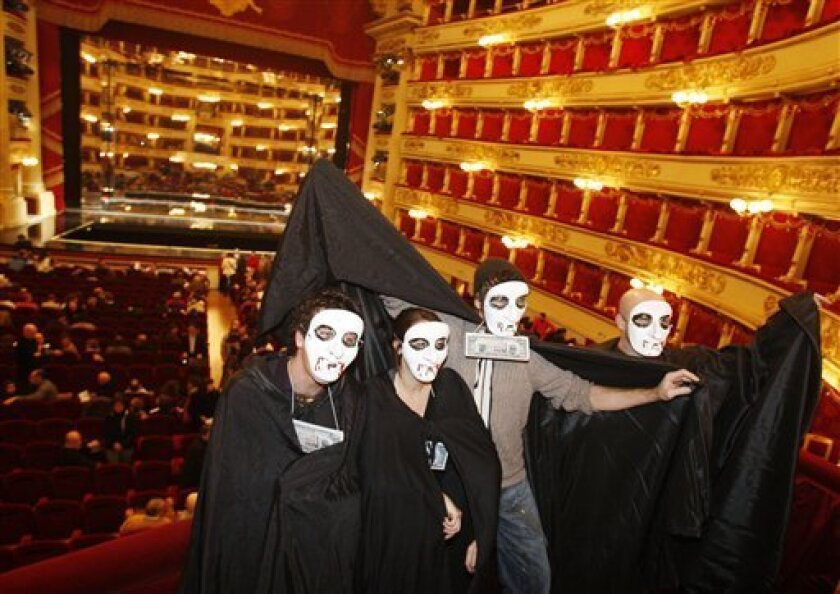 In this Wednesday, Nov. 19, 2008 file photo, La Scala theater workers protest during an assembly inside the renowned theater in Milan, Italy. The management of La Scala says a union representing orchestra and choir members agreed Monday evening, Dec. 1, 2008 to accept a new contract. The opera is being directed by Daniele Gatti and opens the new season Dec. 7. (AP Photo/Luca Bruno, files)