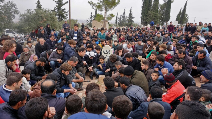 Mourners attend the funeral of Raed Fares and Hamoud Juneid in the village of Kafranbel in the northwestern Syrian province of Idlib on Friday.