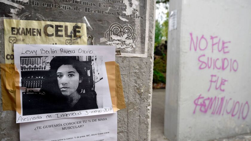 A picture of Lesby Berlin Osorio is seen on a wall on May 5, 2017, near where her body was found out