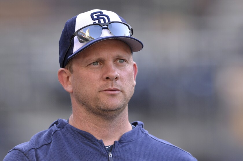 FILE - In this Aug. 23, 2019, file photo, San Diego Padres' Andy Green looks on before a baseball game against the Boston Red Sox, in San Diego. The Chicago Cubs named former San Diego Padres manager Andy Green as bench coach Monday, Dec. 9, 2019. (AP Photo/Orlando Ramirez, File)
