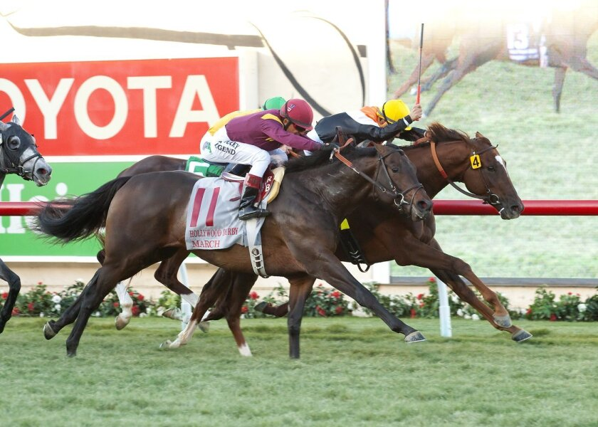 In a photo provided by Benoit Photo, Chiropractor and jockey Corey Nakatani, right, score a narrow victory over March, foreground, with Rafael Bejarano, and Om, background, with Gary Stevens, in the Grade I, $300,000 Hollywood Derby horse race Saturday, Nov. 28, 2015, at Del Mar Thoroughbred Club in Del Mar, Calif. (Benoit Photo via AP)