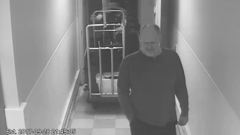 In this Sept. 28, 2017, security camera image released by MGM Resorts, Stephen Paddock is followed b