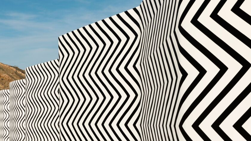 """A detail from Claudia Comte's """"Curves and Zigzags,"""" an Op Art sculptural painting."""