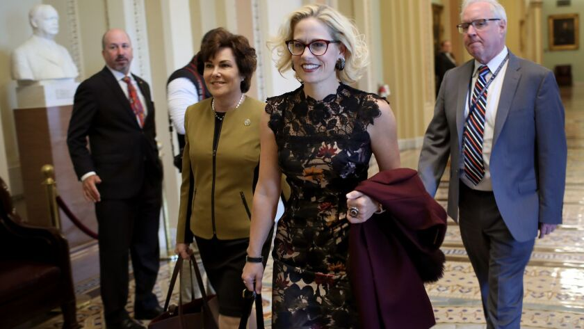 Newly-elected Democratic senators-elect Kyrsten Sinema (L) (D-AZ) and Jacky Rosen (R) (D-NV) walk to the office of Senate Minority Leader Chuck Schumer for a meeting at the U.S. Capitol November 13, 2018 in Washington, DC.