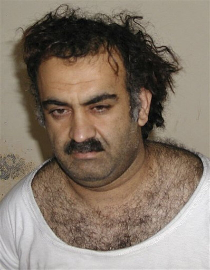 FILE - This March 1, 2003 file picture shows Khalid Sheik Mohammed, shortly after his capture during a raid in Pakistan. White House aides are increasingly convinced that accused 9/11 mastermind Khalid Sheikh Mohammed will never face trial in a civilian court and are trying to cut a deal that would still transfer Guantanamo Bay terrorism suspects to the U.S., where many would faces charges, a senior administration official said Monday. (AP Photo, File)