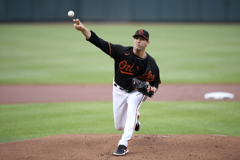 Baltimore Orioles starting pitcher Matt Harvey delivers during the first inning of a baseball game against the Washington Nationals, Saturday, July 24, 2021, in Baltimore. (AP Photo/Nick Wass)