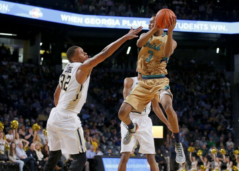 Notre Dame forward V.J. Beachem (3) looks to pass over Georgia Tech forward Nick Jacobs (32) during the first half of an NCAA college basketball game in Atlanta, Saturday, Feb. 20, 2016. (AP Photo/Todd Kirkland)