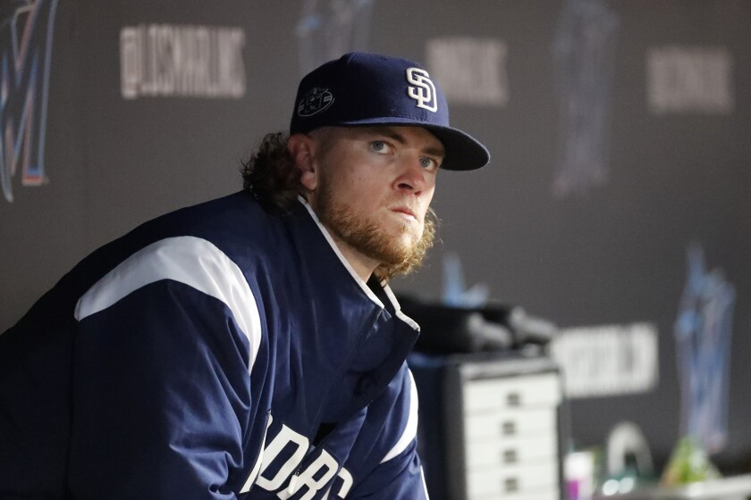 Padres rookie Chris Paddack looks out of the dugout during the eighth inning of Wednesday's game against the Miami Marlins.