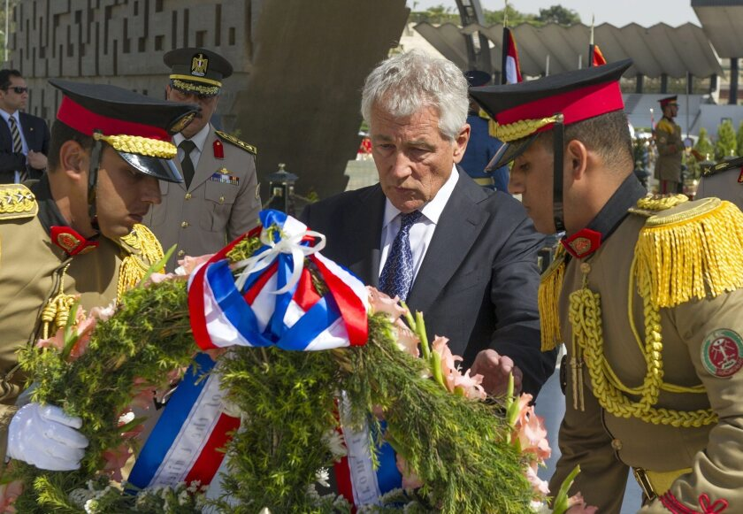 U.S. Defense Secretary Chuck Hagel lays a wreath at the Tomb of the Unknown Soldier in Cairo.